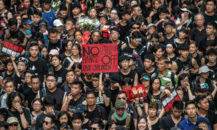 Protesters demonstrate against the now-suspended extradition bill in Hong Kong, on June 16, 2019. (Carl Court/Getty Images)