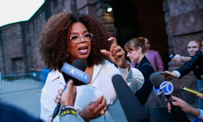 U.S. media executive and talk show host Oprah Winfrey talks to the press as she arrives to the opening celebration of the Statue of Liberty Museum on Liberty Island at the Statue Cruises Terminal in Battery Park in New York on May 15, 2019. (Kena Betancur/AFP/Getty Images)