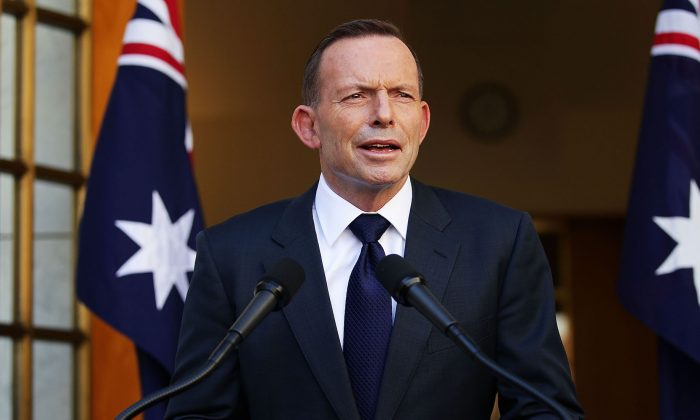 Tony Abbott addresses media at Parliament House in Canberra, Australia, on Sept. 15, 2015. (Stefan Postles/Getty Images)