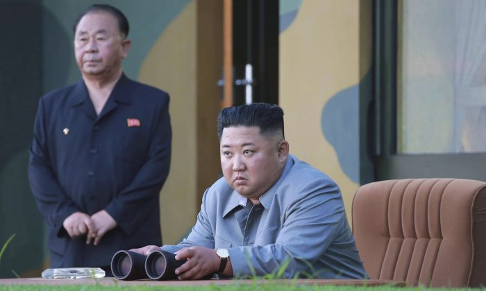 North Korean leader Kim Jong Un watches a missile test in North Korea on July 25, 2019. (Korean Central News Agency/Korea News Service via AP)