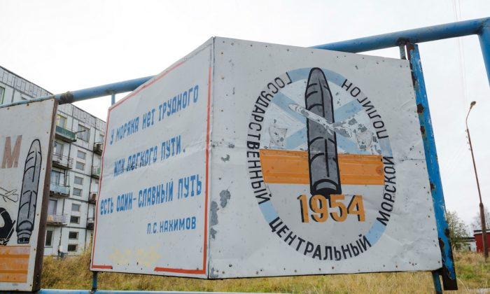 """A view shows a board on a street of the military garrison located near the village of Nyonoksa in Arkhangelsk Region, Russia, on Oct. 7, 2018. The board reads: """"State Central Naval Range"""". (REUTERS/Sergei Yakovlev)"""