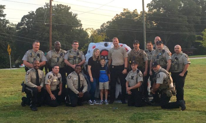 Sheriff's deputies escorted 9-year-old Caden Dixon to his first day of class in Gainesville, Ga., on Aug. 7, 2019. (Hall County Sheriff's Office)