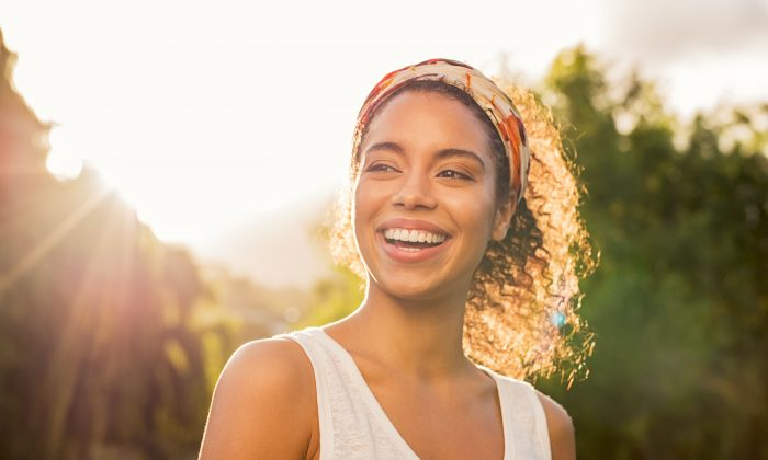 Happiness can be hard to come by, but researchers hope to provide meaningful things people can do to increase their positive emotions. (Rido/Shutterstock)