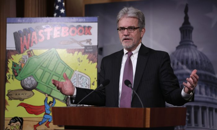 "U.S. Sen. Tom Coburn (R-Okla.) speaks during a news conference on Capitol Hill in Washington Dec. 17, 2013. Coburn held the news conference to release ""Wastebook 2013,"" his annual report of ""examples of wasteful and low-priority spending"" of the U.S. Government.  (Alex Wong/Getty Images)"