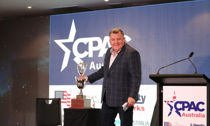 Australian center-right Liberal MP Craig Kelly unveils the 'CPAC Freedom Award' at the first Conservative Political Action Conference (CPAC) Australia on Aug. 10, 2019. (The Epoch Times)