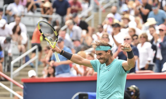 Rafael Nadal of Spain celebrates his 6-3, 6-0 victory over Daniil Medvedev of Russia during the mens singles final of the Rogers Cup at IGA Stadium on August 11, 2019 in Montreal, Quebec, Canada. (Minas Panagiotakis/Getty Images)