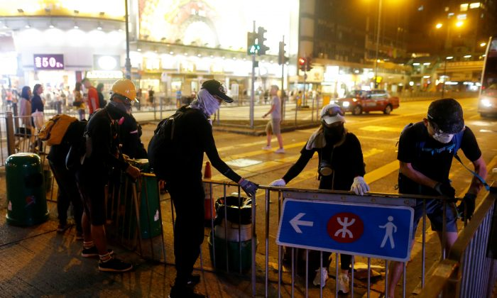 Anti-extradition bill protesters set up a roadblock at Tsim Sha Tsui neighborhood in Hong Kong, on Aug. 10, 2019. (Thomas Peter/Reuters)