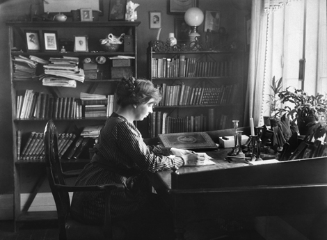 "Sigrid Undset working at Bjerkebaek, where she finished her trilogy ""Kristin Lavransdatter"" during the years 1920–1922. (Public Domain)"