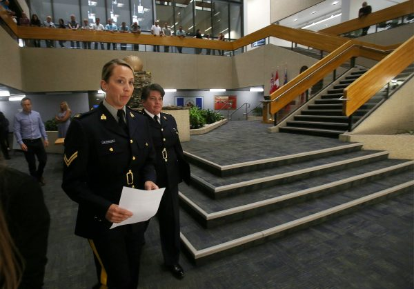 "RCMP Corporal Julie Courchaine (L) and Assistant Commissioner Jane MacLatchy prepare to speak to members of the media regarding two bodies believed to be those of fugitives Kam McLeod and Bryer Schmegelsky found near Gillam, MB, at the RCMP ""D"" Division Headquarters, August 7, 2019. (Shannon VanRaes/Reuters)"