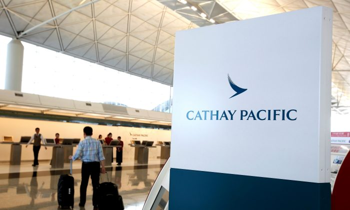 A passenger walks to the First Class counter of Cathay Pacific Airways at Hong Kong Airport in Hong Kong, China on April 4, 2018. (Bobby Yip/Reuters)