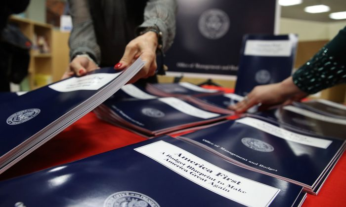 "Copies of U.S. President Donald Trump's overview of budget priorities for FY2018, titled ""America First: A Budget Blueprint to Make America Great Again."" are put on display at the Government Publishing Office (GPO) and the Office of Management and Budget, in Washington on March 16, 2017.  (Mark Wilson/Getty Images)"