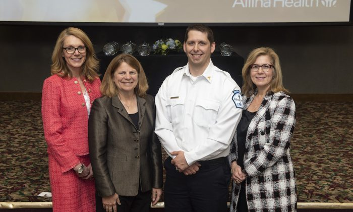 Ivan Mazurkiewicz (2nd L) at the Allina Health Commitment to Care Awards ceremony. (Courtesy of Allina Health)