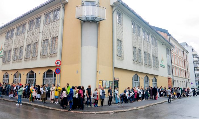 People gather outside the Islamic Cultural Centre to show solidarity with the Muslim community after Saturday's shooting at a mosque, in Oslo, Norway, on Aug. 11, 2019. (Fredrik Hagen/NTB Scanpix/via Reuters)