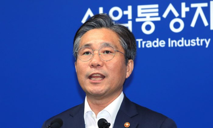 South Korean Trade Minister Sung Yun-mo speaks during a press conference at the government complex in Sejong, South Korea, on Aug. 12, 2019. (Jin Sung-chul/Yonhap via AP)