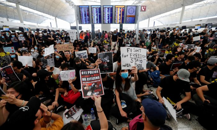 Anti-extradition bill demonstrators attend a protest at the departure hall of Hong Kong Airport, China on Aug.12, 2019. (Issei Kato/Reuters)