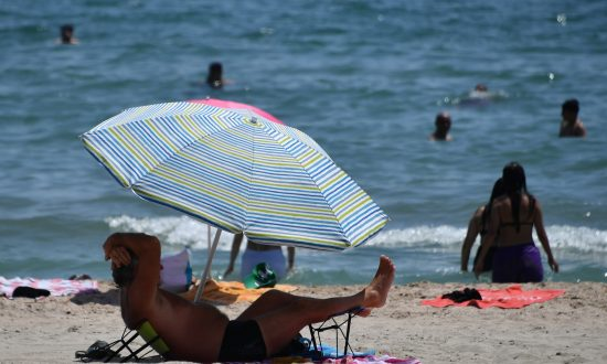 Teenager Impaled by Flying Umbrella at Beach, Rushed to Hospital