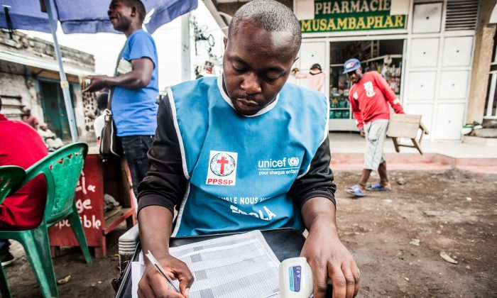 A health worker registers temperatures of people checked in Goma, Democratic Republic of Congo, on July 31, 2019. (Pamela Tulizo/AFP/Getty Images)