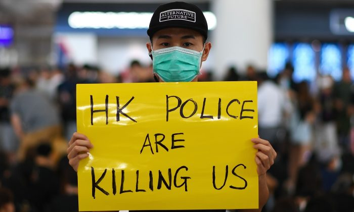 Pro-democracy protesters gather against the police brutality and the controversial extradition bill at Hong Kong's international airport on Aug. 12, 2019. (Manan Vatsyayana/AFP/Getty Images)