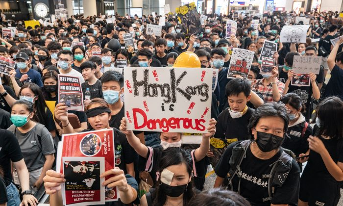 Protesters occupy the arrival hall of the Hong Kong International Airport during a demonstration in Hong Kong, on Aug. 12, 2019. (Anthony Kwan/Getty Images)
