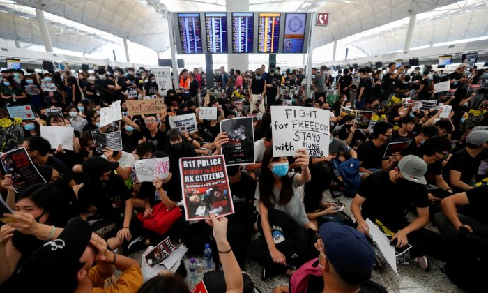 Anti-extradition bill demonstrators attend a protest at the departure hall of Hong Kong Airport, on Aug. 12, 2019. (Issei Kato/Reuters)