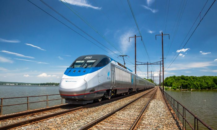 The Acela Express travels over the Bush River rail bridge in Maryland. (Amtrak)