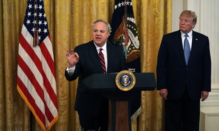 Secretary of Interior David Bernhardt (L) speaks as President Donald Trump (R) looks on during an East Room event on the environment at the White House in Washington on July 7, 2019.  (Alex Wong/Getty Images)