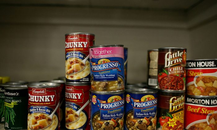Canned food that will be packed into boxes for needy families is seen on a packing table at the Alameda County Community Food Bank in Oakland, Calif., on Dec. 18, 2008. (Justin Sullivan/Getty Images)