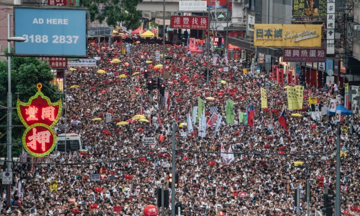 Protesters march on a street during a rally against a controversial extradition law proposal in Hong Kong on June 9, 2019. (Anthony Kwan/Getty Images)