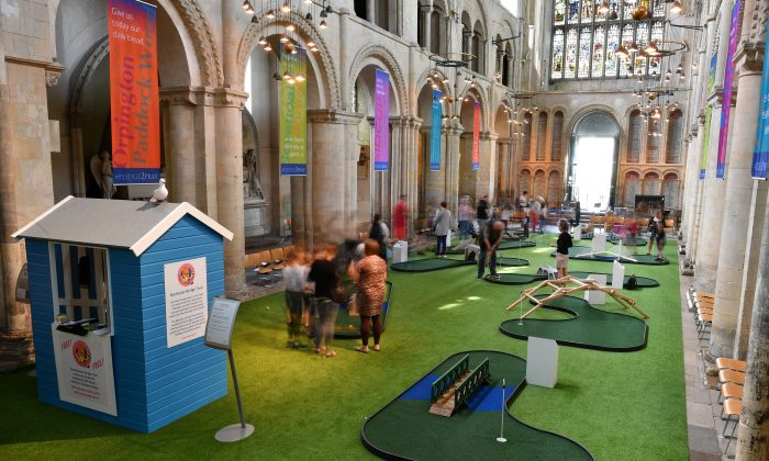 People play on the bridge-themed mini-golf course set up in the nave of Rochester Cathedral in Rochester, southeast England, on August 6, 2019.  BEN STANSALL/AFP/Getty Images