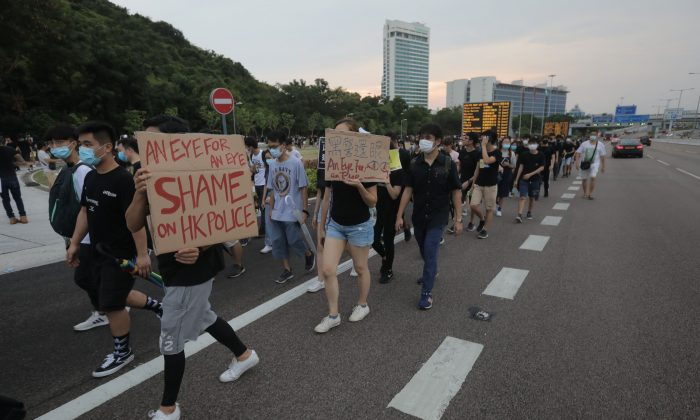 Protesters walk on a highway near Hong Kong's international airport following a protest against the police brutality and the controversial extradition bill on Aug. 12, 2019.         (Vivek Prakash/AFP/Getty Images)