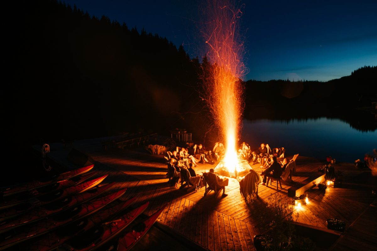 Bonfire on the dock at Nimmo Bay Wilderness Resort. (Courtesy of Nimmo Bay Wilderness Resort)