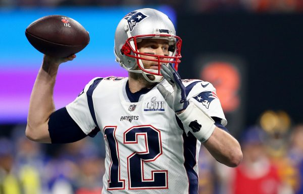 Tom Brady #12 of the New England Patriots attempts a pass against the Los Angeles Rams in the first quarter during Super Bowl LIII