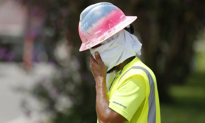 A worker at a construction site on the Duncan Canal in Kenner, La., on Aug. 13, 2019. (AP Photo/Gerald Herbert)