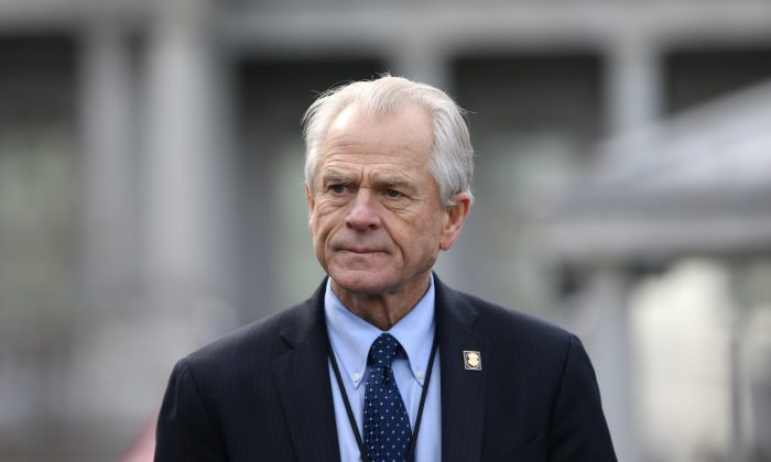 White House trade adviser Peter Navarro listens to a news conference about a presidential executive order relating to military veterans outside of the West Wing of the White House in Washington, D.C. on March 4, 2019. (Leah Millis/Reuters)