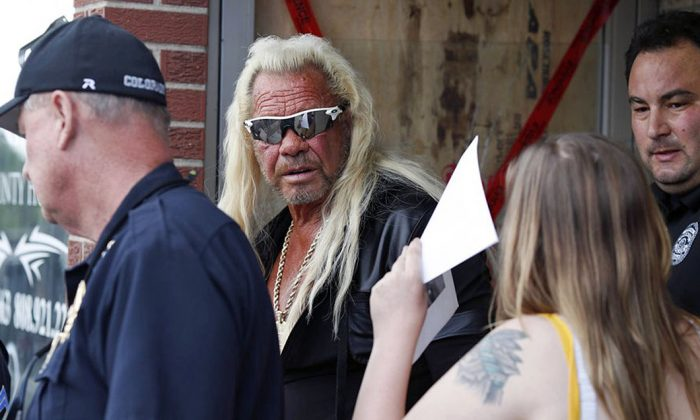 Dog the Bounty Hunter Star Duane Chapman (C) with his daughter Bonnie (front R) in Edgewater, Colo., on Friday, Aug. 2, 2019. (AP Photo/David Zalubowski)