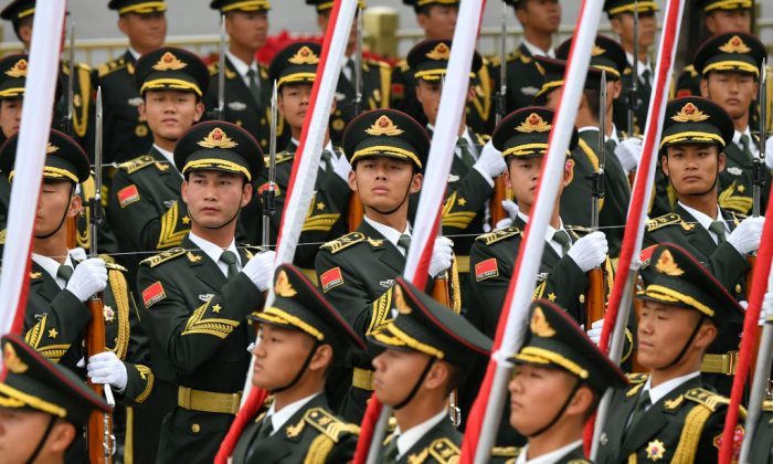 Chinese People's Liberation Army honor guards prepare for a welcome ceremony for Austrian Chancellor Sebastian Kurz at the Great Hall of the People in Beijing on April 28, 2019. (PARKER SONG/AFP/Getty Images)