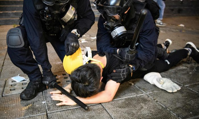 Police arrest a man during protests in Tsim Sha Tsui in Hong Kong on Aug. 11, 2019. (Anthony Wallace/AFP/Getty Images)