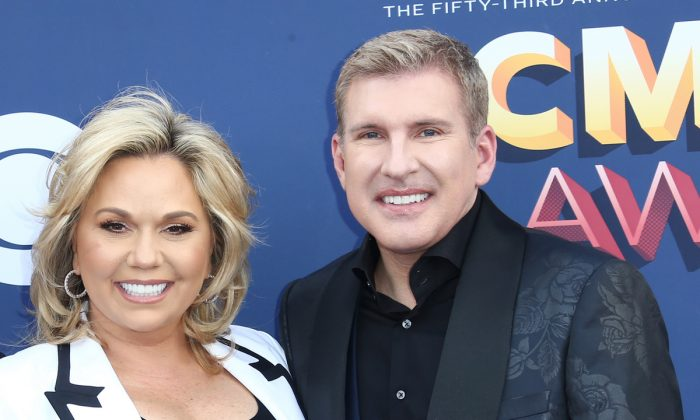Julie Chrisley (L) and Todd Chrisley attend the 53rd Academy of Country Music Awards at MGM Grand Garden Arena in Las Vegas, Nev., on April 15, 2018. (Tommaso Boddi/Getty Images)