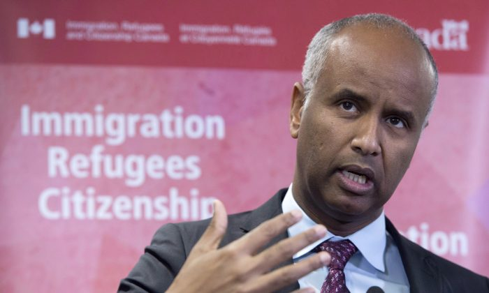 Minister of Immigration Ahmed Hussen makes an announcement in Toronto on Jan. 14, 2019. The OECD says Canada's immigration programs are moving the needle in attracting talented foreigners. The country has for decades managed labour migration to achieve the highest share of well-educated foreign-born people among OECD nations. (The Canadian Press/Frank Gunn)