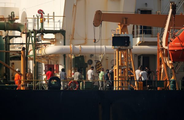 Crew members are pictured as Iranian oil tanker Grace 1 sits anchored awaiting a court ruling on whether it can be freed