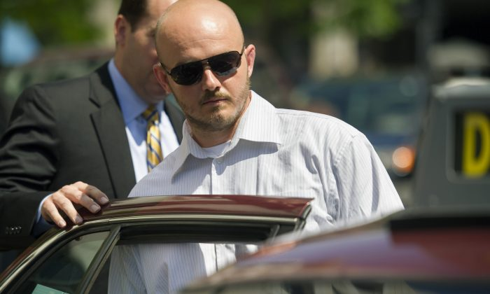 Former Blackwater Worldwide guard Nicholas Slatten enters a taxi cab as he leaves federal court in Washington, after the start of his trial on June 11, 2014. (AP Photo/Cliff Owen, File)