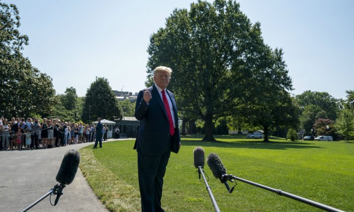 President Donald Trump speaks to members of the press before departing from the White House on the south lawn before he boards Marine One in Washington on Aug. 9. (Tasos Katopodis/Getty Images)