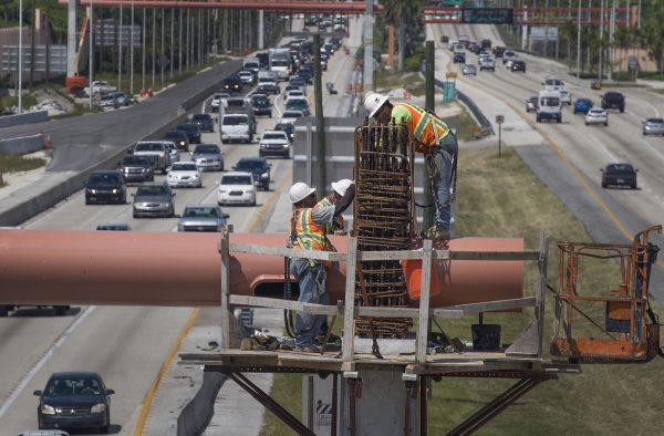 Workers on a Florida Turnpike interchange construction site in Miami