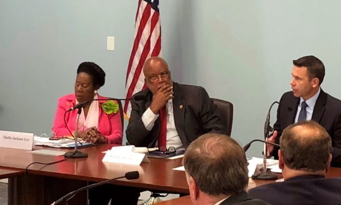 Democratic U.S. Reps. Sheila Jackson Lee of Texas and Bennie Thompson of Mississippi listen as the U.S. acting secretary of homeland security, Kevin K. McAleenan, speaks at a federal building in Jackson, Miss., on Aug. 13, 2019. (AP Photo/Emily Wagster Pettus)