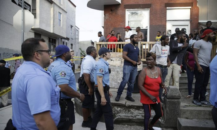 Police urge people to leave the area as they investigate an active shooting situation on Aug. 14, 2019, in the Nicetown neighborhood of Philadelphia. (Matt Rourke/AP)