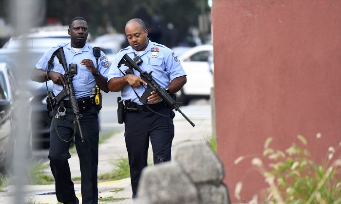 Police officers carrying assault rifles respond to a shooting in Philadelphia, Pa., on Aug. 14, 2019. (Mark Makela/Getty Images)
