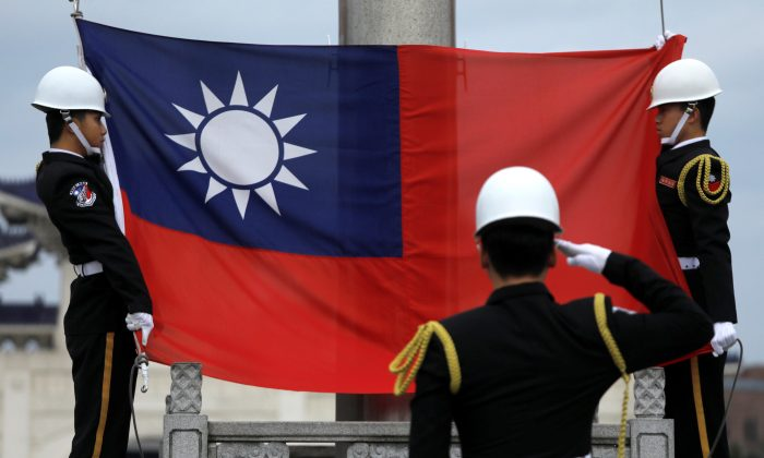 Military honor guards attend a flag-raising ceremony at Chiang Kai-shek Memorial Hall, in Taipei, Taiwan on March 16, 2018. (Tyrone Siu/Reuters)