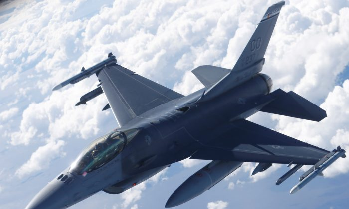 A U.S. Air Force F-16 fighter taking part in the U.S.-led Saber Strike exercise flies over Estonia on June 6, 2018. (Ints Kalnins/Reuters)