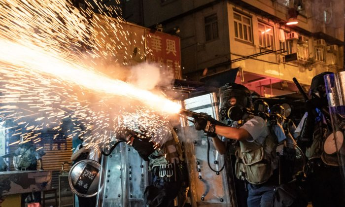 Police fire tear gas to clear pro-Democracy protesters during a demonstration on Hungry Ghost Festival day in the Sham Shui Po district in Hong Kong on Aug. 14, 2019. (Anthony Kwan/Getty Images)