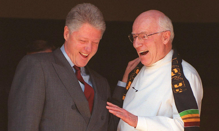 President Bill Clinton (L) laughs with Foundry Methodist Church Pastor Philip Wogaman after Sunday Services in Washington on Feb. 14, 1999. (Tim Sloan/AFP/Getty Images)